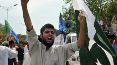 "Islamabad: An activist of Pakistan's Islami Jamiat Talba (""Islamic Organisation of Male Students"") chants slogans during a protest march towards the US embassy in Islamabad on July 8, 2011. (AFP Photo/Farooq Naeem)"