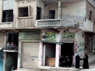 A bullet-riddled building in Rastan, near the flashpoint city of Homs, on March 14, 2012 (AFP Photo / STR)