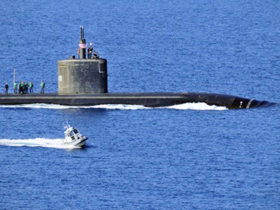 Greece: The Los Angeles-class attack submarine USS Annapolis is escorted by a US Naval Support Activity harbor security boat as she departs Souda harbor in Souda Bay, Greece on March 30, 2010. (AFP Photo / Paul Farley)