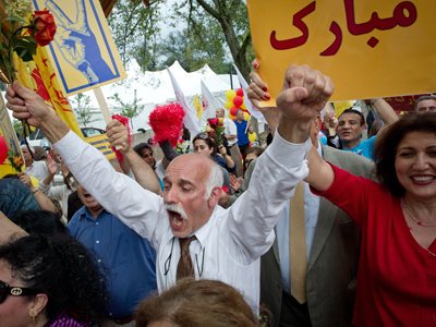 A supporter of the Iranian opposition group based abroad, the People's Mujahedeen of Iran (Mujahedeen-e-Khalq) shouts slogans as celebrate the removal of the group from the US black list of designated terror groups in Washington, DC on September 28, 2012 (AFP Photo / Mark Garten)