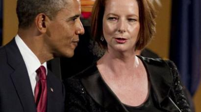 Australian Prime Minister Julia Gillard speaks with US President Barack Obama as they arrive for a Parliamentary Dinner at Parliament House in Canberra on November 16, 2011 (AFP Photo / Jim WATSON)