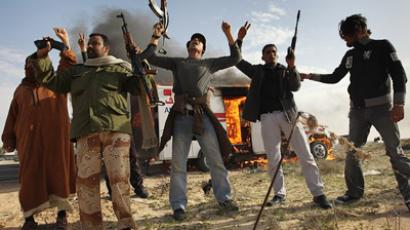 Rebel fighters celebrate after advancing on the front line against Libyan government forces on March 2, 2011 in al-Brega, Libya