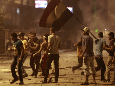 Protesters take their positions during clashes with riot police along a road at Kornish El Nile in the tunnel which leads to the U.S. embassy, near Tahrir Square in Cairo September 15, 2012. (Reuters/Amr Abdallah Dalsh)