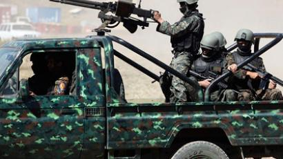 Members of Yemen's U.S.-trained counter-terrorism force arrive to field training near Sanaa. (Image from allvoices.com)