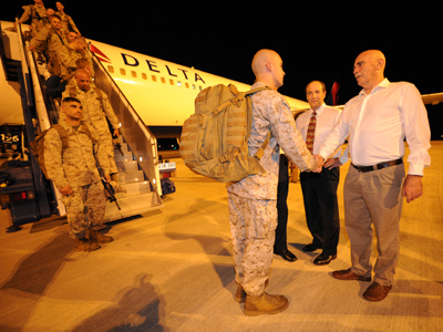 Company Commander, Captain Christopher Richardella of the United States Marines of Fox Company, 2nd Battalion, 3rd Marine Regiment is greeted by Australian MP, Warren Snowdon (R), upon arrival at the Royal Australian Air Force Base in Darwin April 4, 2012 (Reuters/Australian Department of Defence/Handout)