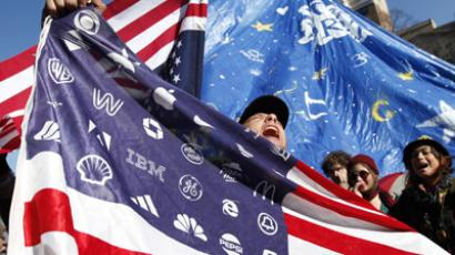 Occupy DC demonstrators sing in McPherson Square in Washington. (Reuters / Kevin Lamarque)
