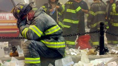 A firefighter breaks down after the World Trade Center buildings collapsed September 11, 2001 after two hijacked airplanes slammed into the Twin Towers in a terrorist attack (AFP Photo / Mario Tama)