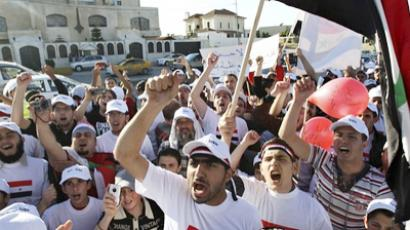 Syrian people living in Jordan shout slogans against Syria's President Bashar Al-Assad during a demonstration in front of the Syrian embassy in Amman (AFP Photo / Getty Images)