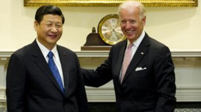 Joe Biden (R) and Xi Jinping at the White House in Washington, DC, February 14, 2012 (AFP Photo / Jim Watson)