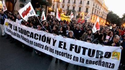 Protesters march during a demonstration against cuts on public services in central Valencia. (REUTERS/Heino Kalis)