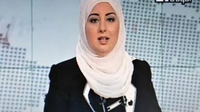 Egyptian state TV shows anchorwoman Fatma Nabil wearing a hijab while presenting.(AFP Photo / Egyptian TV)