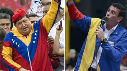 Henrique Capriles (R) and Hugo Chavez (AFP Photo / Juan Barreto)