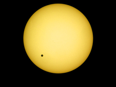A picture taken 08 June 2004 shows the planet Venus transiting in front of the sun. The last visible transit of Venus occurred 06 December 1882 and the next one will be in 2012. (AFP Photo / Attila Kisbenedek)