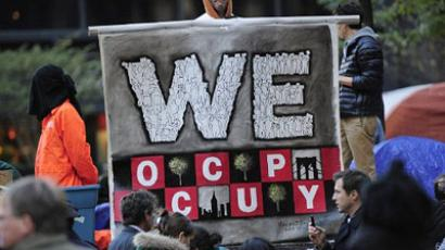 New York : An Occupy Wall Street supporter dressed as a corporate zombie holds a sign at Zuccotti Park in New York on October 30, 2011. (AFP Photo/Emmanuel Dunand)