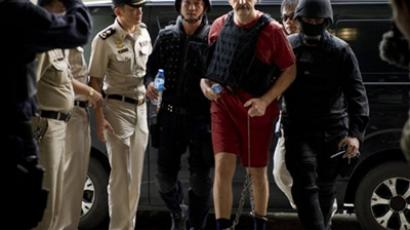 Viktor Bout is escorted by members of the special police unit  (AFP Photo / Nicolas Asfouri)