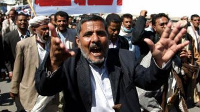 A Yemeni man shouts slogans as anti-regime protesters, inspired by the suspension of Syria from the Arab League, stage a massive rally in Sanaa on November 16, 2011 to urge the regional grouping to do the same with Yemen (AFP Photo / MOHAMMED HUWAIS)