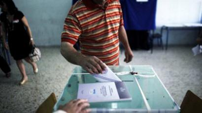 : A man casts his vote for Greece's general elections at a polling station in Athens on May 6, 2012. (AFP Photo / Angelos Tzortzinis)