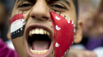 Cairo: an Egyptian protester shouts slogans during a demonstration in Tahrir Square (AFP Photo / Odd Andersen)