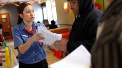 McDonald's employee assists job applicants during a one-day hiring event at a McDonald's restaurant in San Francisco, California (AFP Photo / Getty Images)