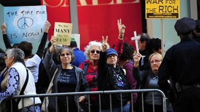 New York : Peace group protestors and members of Occupy Wall Street stage. (AFP Photo/Emmanuel Dunand )