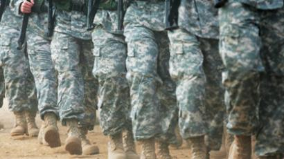 United States military march, with troops in camouflage attire