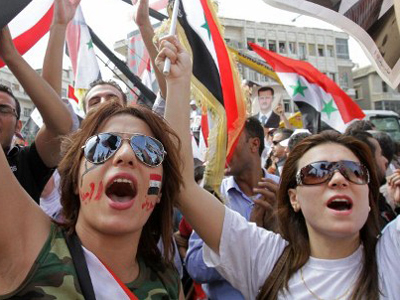 Supporters of Syrian President Bashar al-Assad shout slogans during a pro-regime rally in Damascus on October 12, 2011 (AFP Photo / Louai Beshara)