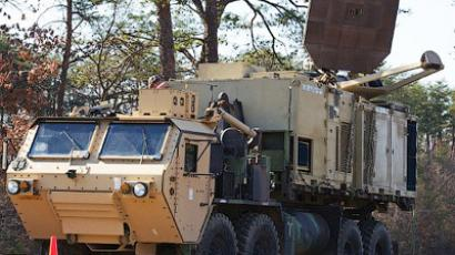 Two versions of US Marine Corps trucks are seen carrying the Active Denial System, March 9th, 2012, at the US Marine Corps Base Quantico, Virginia (AFP Photo / Paul J. Richards)Video uploaded by USFORCESTV channel