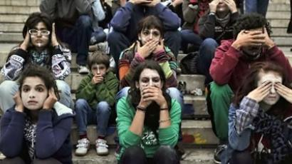 Greek indignants sitting at central Athens Syntagma square in front of the Greek Parliament during the global day of action on October 15, 2011.  (AFP Photo / Louisa Gouliamaki)
