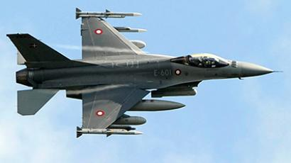 A Danish F-16 Fighting Falcon jet fighter flies over the Sigonella NATO Airbase in the southern Italian island of Sicily March 19, 2011 (Reuters/Antonio Parrinello)