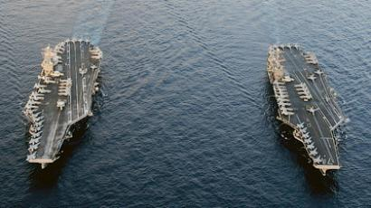 The Nimitz-class aircraft carriers USS Abraham Lincoln (CVN 72) and USS John C. Stennis (CVN 74) join for a turnover of responsibility in the Arabian Sea in this U.S. Navy handout photo dated January 19, 2012 (Reuters / U.S. Navy / Chief Mass Communication Specialist Eric S. Powell / Handout)