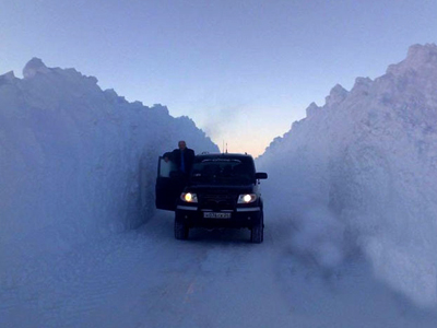 Snowpocalypse Russia: 'Snow tsunami' swallows streets, cars, buildings (PHOTOS)