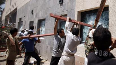Protesters break the windows of the U.S. embassy in Sanaa September 13, 2012. (Reuters/Khaled Abdullah; Youtube video courtesy of mediacentersanaa)