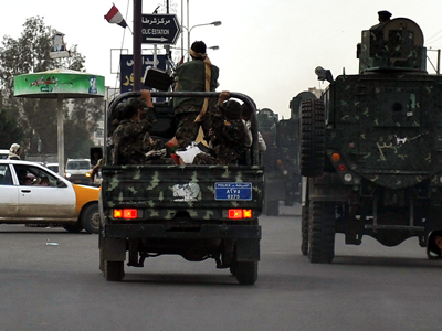 Yemeni security forces patrol a street in the capital Sanaa on August 14, 2012 (AFP Photo / Mohammed Huwais)