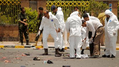 Forensic policemen inspect the site of a suicide bomb attack at a parade square in Sanaa May 21, 2012 (Reuters/Khaled Abdullah)