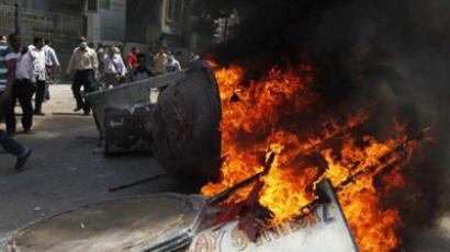 Egyptian protesters set fire to billboard signs outside the interior ministry in central Cairo on June 29, 2011 (AFP Photo / Getty Images)
