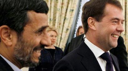Russian President Dmitry Medvedev (R) and his Iranian counterpart Mahmoud Ahmadinejad smile during their bilateral meeting on the sidelines of a Caspian regional summit in Baku on November 18, 2010 (AFP Photo / RIA-Novosti /  Kremlin Pool / Dmitry Astakhov)