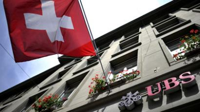 A Swiss flag flies above a branch of Swiss banking giant UBS (AFP Photo/Fabrice Coffrini)