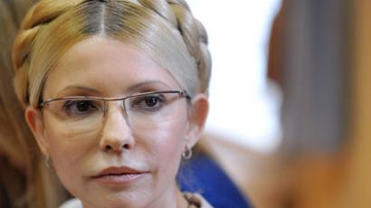 Yulia Tymoshenko listens as Judge Rodion Kireyev of the Kiev Pechersky court renders his verdict on her case on October 11, 2011.(AFP Photo / Sergei Supinsky)