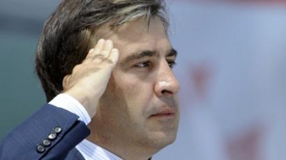 Tbilisi : Georgian President Mikheil Saakashvili salutes on May 26, 2011 in Tbilisi during a showpiece military parade marking Georgia's independence from Moscow. (AFP Photo / Vano Shlamov)