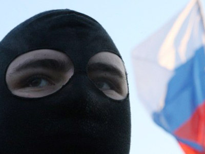 A masked participant rallies with some 600 Russian football fans and nationalists on January 15, 2011 in Saint Petersburg to commemorate the death of Yegor Sviridov, a Spartak Moscow football club fan, who was shot last month in a brawl as investigators said the fight leading to his killing was started by migrants from the Russian Caucasus. (AFP Photo / Kirill Kudryavtsev)