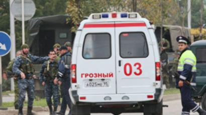 Law enforcement officers at the scene of the special operation during which militants who attacked the Chechen parliament on Tuesday were eliminated. (RIA Novosti / Said Tsarnaev)