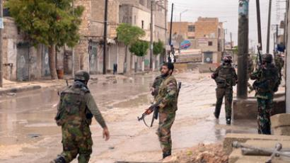 Syrian army soldiers patrol the Sheik Said neighbourhood of Syria's northern city of Aleppo.(AFP Photo / STR)