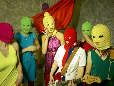 Pussy Riot supporters wearing the band's trademark colored balaklavas