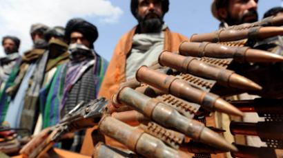 Taliban fighters display their weapons  in Herat province, Afghanistan (AFP Photo / Aref Karimi)