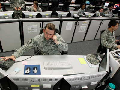 MSgt Michael Gregory, senior operations controller, works at the Air Force Space Command Network Operations & Security Center at Peterson Air Force Base in Colorado Springs, Colorado July 20, 2010. (Reuters / Rick Wilking)