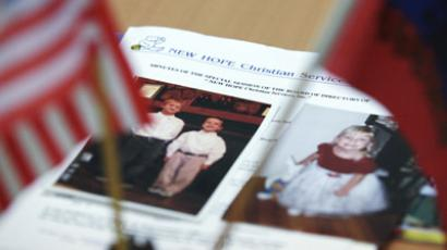 "Photographs of adopted children in the Russian office of the adoption agency ""New Hope Christian Services"" in St. Petersburg. (RIA Novosti/Igor Rustak)"
