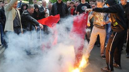 Supporters of nationalist parties burn red flags during a protest in Lviv, eastern Ukraine, during a Victory day celebration marking the anniversary of the end of WWII on May 9, 2011 (AFP Photo / Yurko Dyachyshyn)