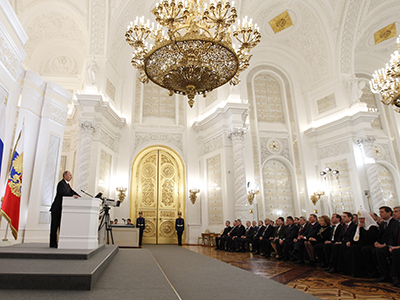 Russian President Vladimir Putin, left, delivers his address to the Russian Federal Assembly at the Kremlin's St. George Hall on December 12, 2012. (RIA Novosti / Dmitry Astakhov)