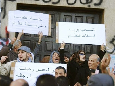 People chanting and holding anti-government signs during recent days of unrest in Benghazi, Libya