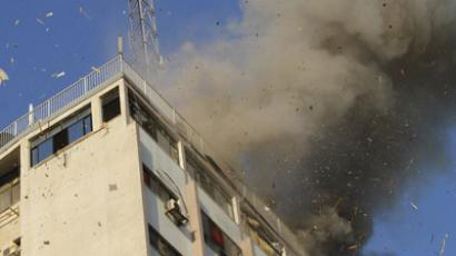 Smoke rises after an Israeli air strike on an office of Hamas television channel Al-Aqsa in Gaza City on November 18, 2012. An Israeli air strike hit a Gaza City media building on November 18, injuring at least six journalists, as a separate raid in northern Gaza killed two people, Palestinian medical sources said. (AFP Photo/Mohammed Abed)